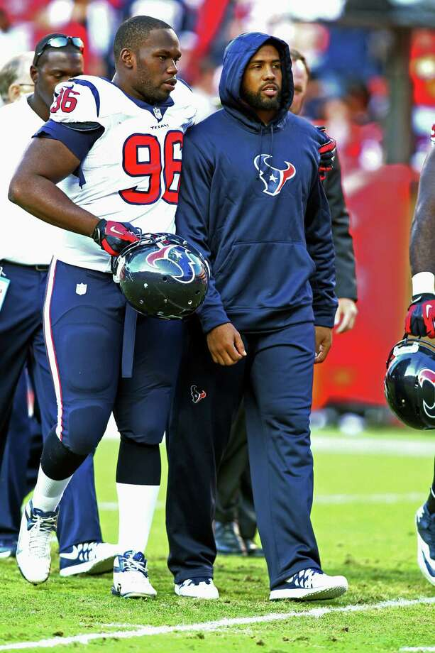 Running back Arian Foster (right), with defensive end Tim Jamison, suffered a hamstring injury against the Chiefs on Oct. 20. Foster has rushed for 542 yards this season. Photo: Tim Umphrey / Associated Press