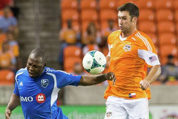 Forward Will Bruin, right, netted a pair of goals to help the Dynamo dispatch Nelson Rivas and the Impact on Thursday night.