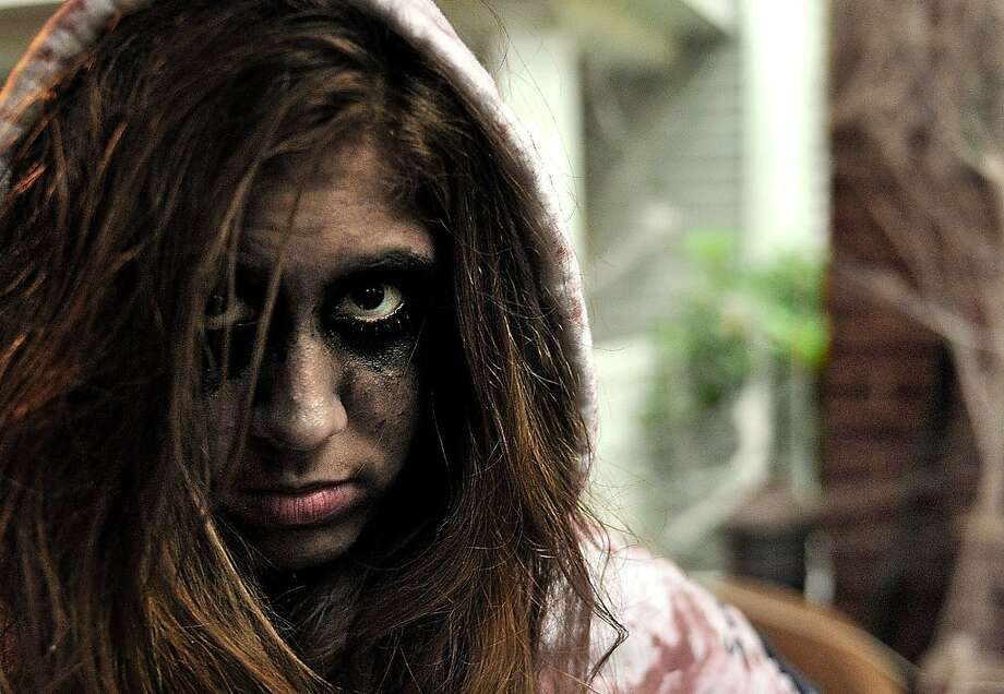 Grace DeVies, 13, of Millcreek Township is photographed on Halloween while trick-or-treating between 4th and 6th streets on Lincoln Ave., in Erie, Pa.,  on Thursday, Oct 31, 2013. (AP Photo/Erie Times-News,  JARID A. BARRINGER) TV OUT; MAGS OUT; COMMERCIAL INTERNET OUT* Photo: Jarid A. Barringer, Associated Press