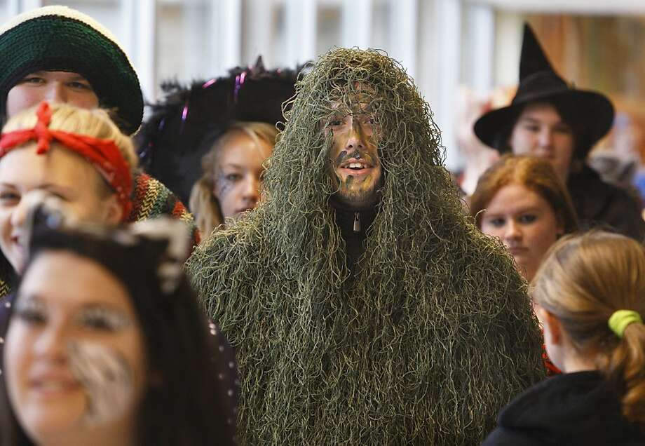 No one will notice while I slowly slip out the back exit:Port Jervis (Pa.) High School seniors march through the school during its annual Halloween Parade. Photo: Tom Bushey, Associated Press