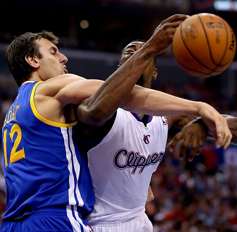 DeAndre Jordan (right), is fouled by Andrew Bogut, prompting an altercation. Photo: Luis Sinco, McClatchy-Tribune News Service