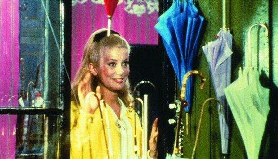 THE UMBRELLAS OF CHERBOURG, a lilting musical, starring Catherine Deneuve.
