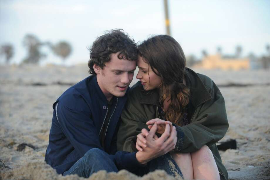 "Anton Yelchin and Felicity Jones in ""Like Crazy,"" about a British student who falls for an American and is then banned from the U.S. after overstaying her visa. Photo: Paramount Pictures, ONLINE_YES / ONLINE_YES"