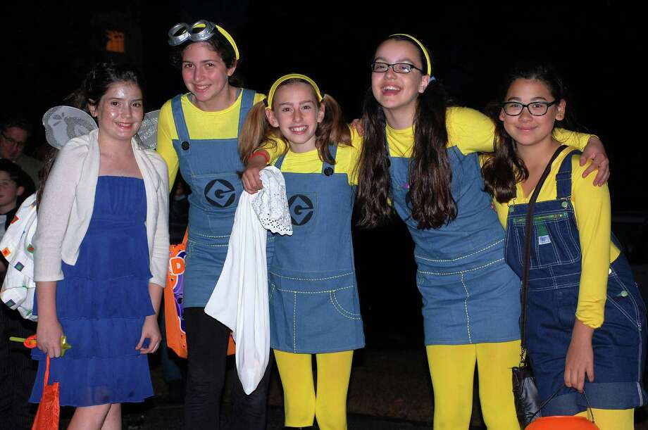 "These ""Minions,"" familiar to fans of  ""Despicable Me,"" were a treat to see in the Oak Street neighborhood on Halloween night. Photo: Jarret Liotta / Westport News contributed"