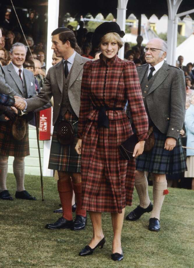 Princess Diana, Princess of Wales and Prince Charles, Prince of Wales attend the Braemar Games in September 1981. Diana, Princess of Wales wears a tartan outfit by Caroline Charles. Photo: Anwar Hussein, WireImage