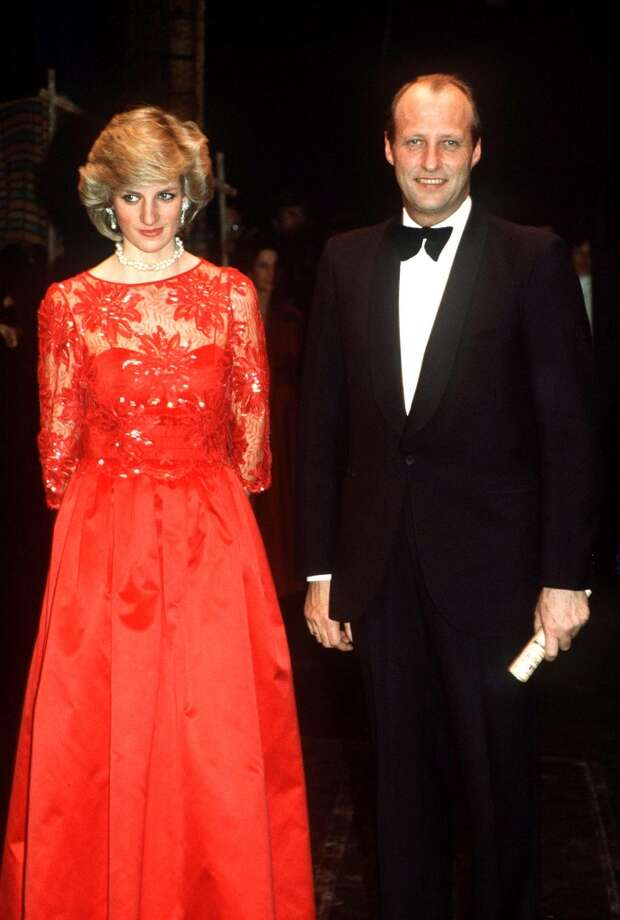 Princess Diana with Crown Prince Harald of Norway at a performance by the London City Ballet in Oslo, Norway, February 1984. She is wearing a red evening gown by Jan van Velden. Photo: Princess Diana Archive, Getty Images