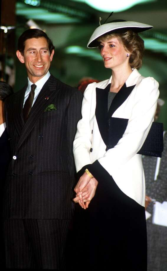 The Prince and Princess of Wales visiting a department store in Tokyo, Japan, May 1986. Princess Diana is wearing a suit by Catherine Walker. Photo: Princess Diana Archive, Getty Images