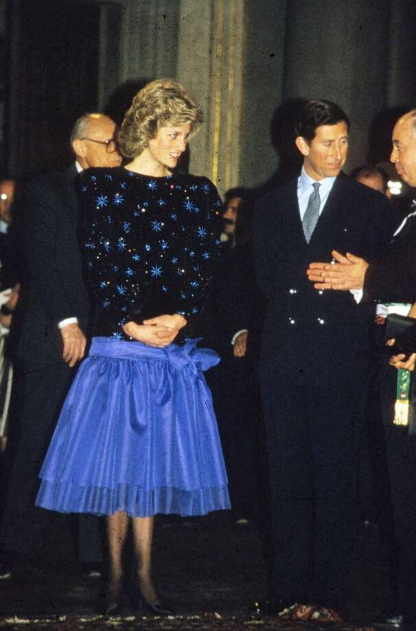 Princess Diana, Princess of Wales and Prince Charles, Prince of Wales attend a dinner held by the Mayor of Florence during a tour of Italy in April, 1985.  Diana wore her first Azagury dress, it had blue stars embroidered on a long fitted black bodice and a bright blue organza skirt tied on the hip with a bow.  ) Photo: Anwar Hussein, WireImage