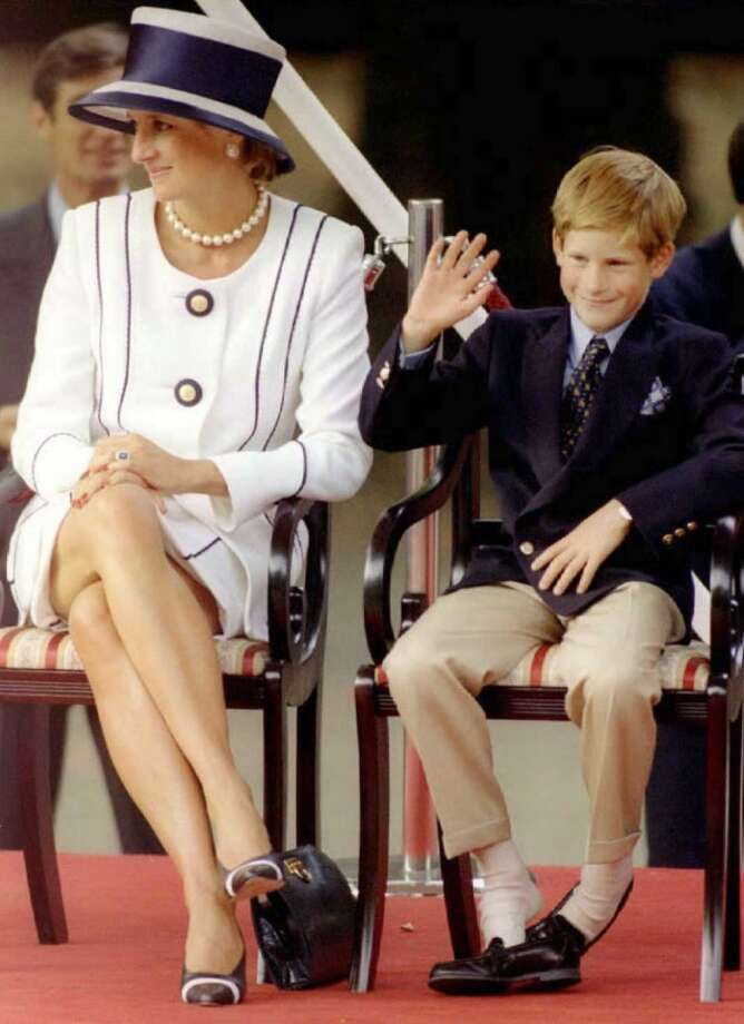 Princess Diana and her son Harry watch veterans as they march past a dais on the Mall. Photo: AFP, AFP/Getty Images
