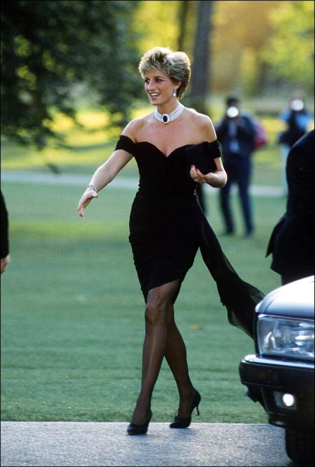 Princess Diana (1961 - 1997) arriving at the Serpentine Gallery, London, in a gown by Christina Stambolian, June 1994. The dress is seen as a statement piece since Prince Charles had earlier than day publically disclosed his infidelity with Camilla Parker-Bowles. Photo: Princess Diana Archive, Getty Images