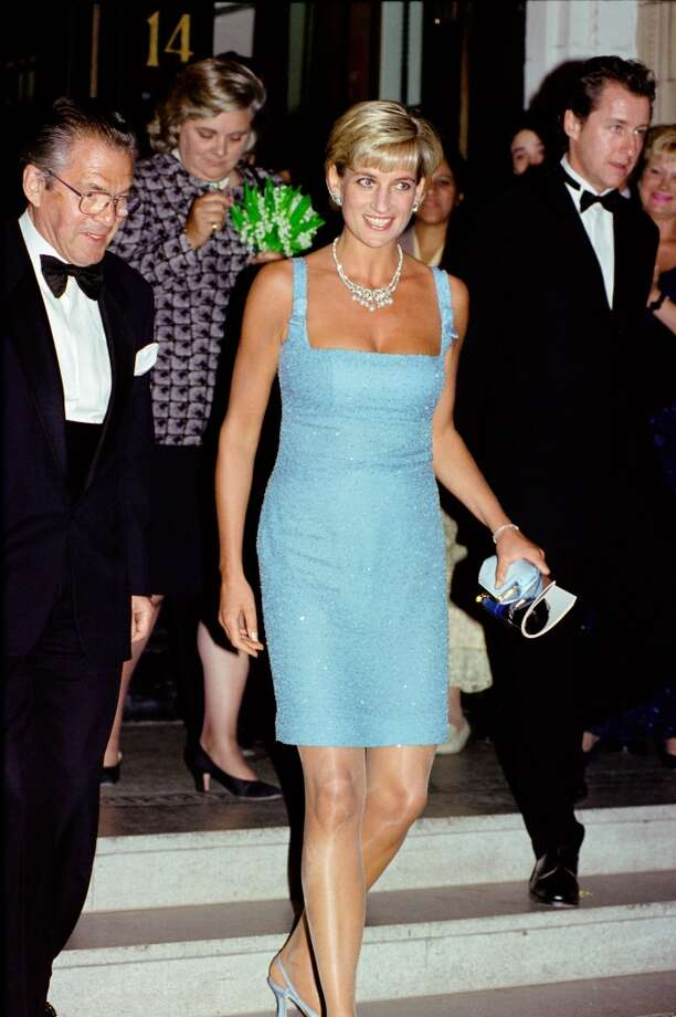 Diana, Princess of Wales as Patron of the English National Ballet, attends their Royal Gala performance of 'Swan Lake' at London's Royal Albert Hall, Walking behind her is Lady-in-waiting Anne Beckwith-Smith, Diana's evening shift dress is by designer Jacques Azagury and her necklace is loaned by Garrard the jewellers Photo: Tim Graham, Tim Graham/Getty Images