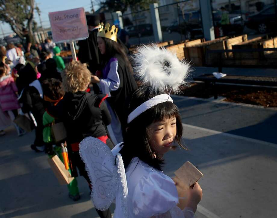 Second trade student Mayu Yamasaki, 7, dressed as an angel for the annual halloween parade at Francis Scott Key Elementary School in San Francisco, Calif., Thursday, October 31, 2013. Photo: Judy Walgren, SFC