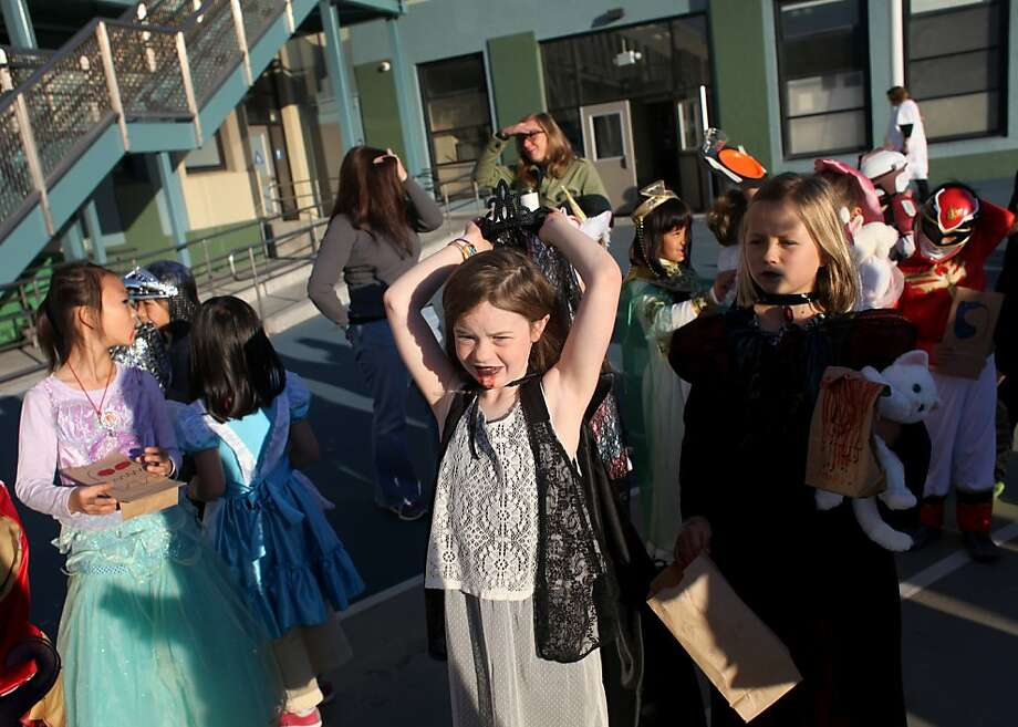 Second-grader Fiona Nickleson, 7, puts her vampire cape around her shoulder as she prepares for the annual halloween parade at Francis Scott Key Elementary School in San Francisco, Calif., Thursday, October 31, 2013. Photo: Judy Walgren, SFC