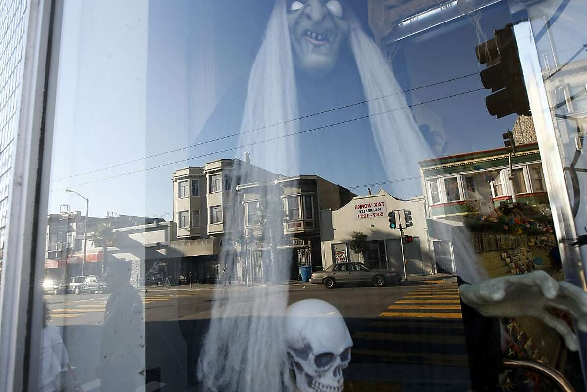 Halloween decorations are seen in the window of a business on Mission St. in the Excelsior District of San Francisco Thursday, October 31, 2013.
