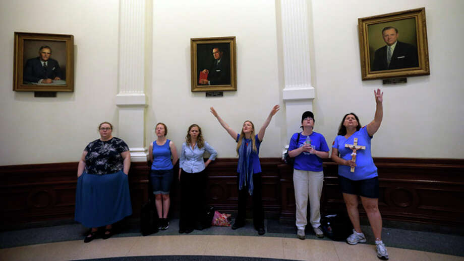 Anti-abortion supporters sing in the rotunda of the Texas Capitol as the Texas House  debates HB 2, a bill that will place restrictions on abortion in the state, Tuesday, July 9, 2013, in Austin, Texas. (AP Photo/Eric Gay) Photo: Eric Gay, ASSOCIATED PRESS / AP2013