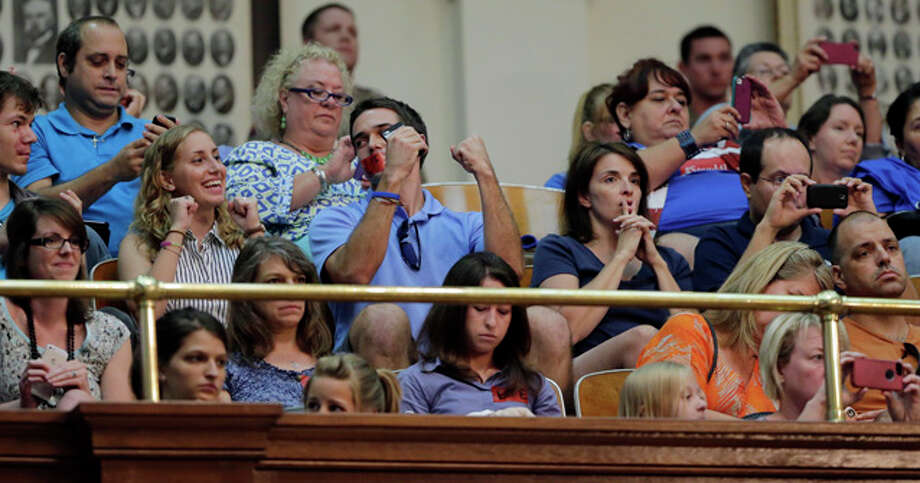 Supporters of HB 2, an abortion bill, react in the gallery of the Texas House after the bill was provisionally approved, Tuesday, July 9, 2013, in Austin, Texas. A final, formal vote is scheduled for Wednesday. The bill  would require doctors to have admitting privileges at nearby hospitals, only allow abortions in surgical centers, dictate when abortion pills are taken and ban abortions after 20 weeks. (AP Photo/Eric Gay) Photo: Eric Gay, AP / AP