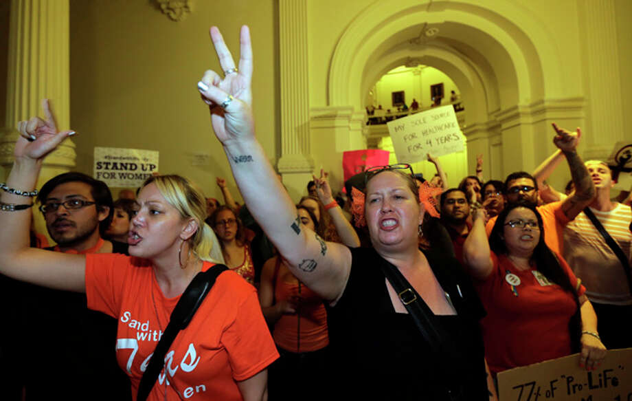 Opponents of HB 2, an abortion bill, yell outside the Texas House after the bill was provisionally approved, Tuesday, July 9, 2013, in Austin, Texas. A final, formal vote is scheduled for Wednesday. The bill  would require doctors to have admitting privileges at nearby hospitals, only allow abortions in surgical centers, dictate when abortion pills are taken and ban abortions after 20 weeks. (AP Photo/Eric Gay) Photo: Eric Gay, AP / AP