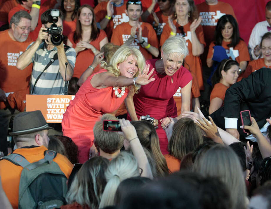 State Sen. Wendy Davis, center left, and Planned Parenthood President Cecile Richards greet the crowd during the Planned Parenthood Action Fund's Stand with Texas Women Rally at Discovery Green in Houston, Texas. The Rally highlighted the abortion restriction bill, House Bill 2 being Pushed in Austin Tuesday, July 9, 2013, in Houston. (AP Photo/Houston Chronicle, Billy Smith II) Photo: Billy Smith II, ASSOCIATED PRESS / 2013 HOUSTON CHRONICLE2013