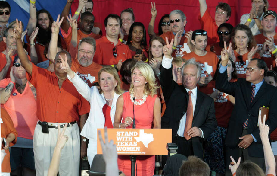 State Sen. Wendy Davis speaks during the Planned Parenthood Action Fund's Stand with Texas Women Rally at Discovery Green in Houston, Texas. The Rally highlighted the abortion restriction bill, House Bill 2 being Pushed in Austin Tuesday, July 9, 2013, in Houston. (AP Photo/Houston Chronicle, Billy Smith II) Photo: Billy Smith II, ASSOCIATED PRESS / 2013 HOUSTON CHRONICLE2013