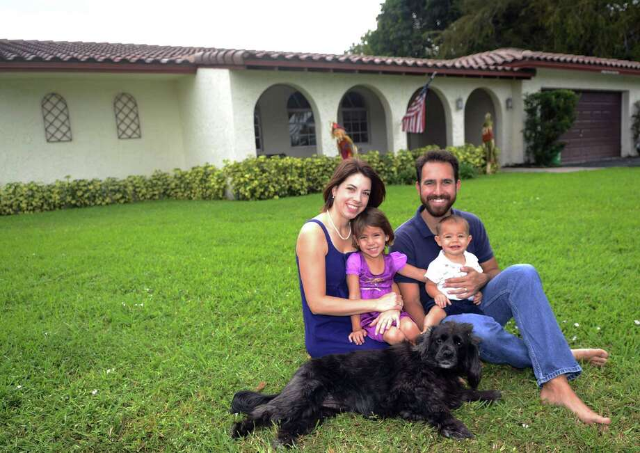 Will Hauser, wife Julina and their children, Emmalena and William, moved into a home in Coral Springs, Fla., that cost more than its appraisal. Photo: Mark Randall / McClatchy-Tribune News Service