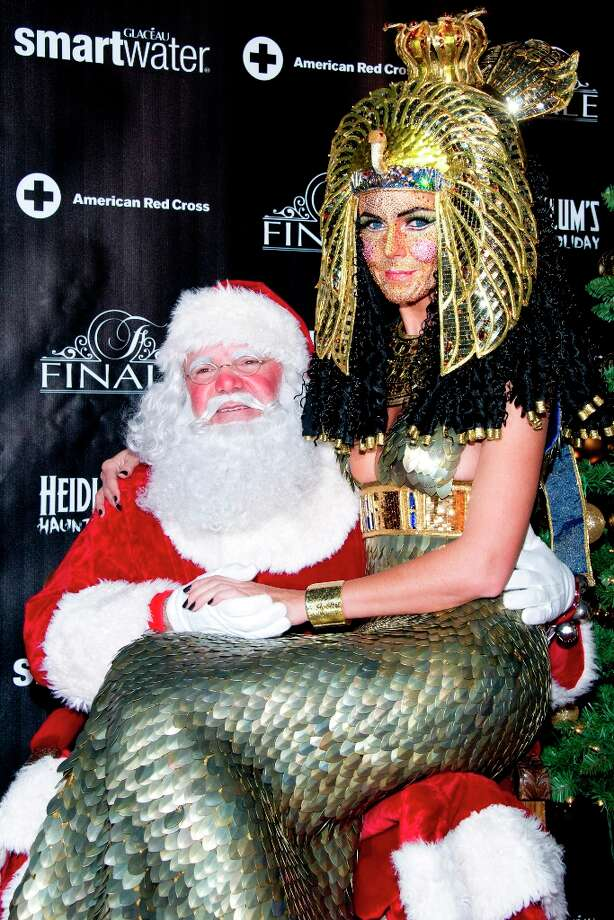 Heidi Klum, dressed as Cleopatra, poses with Santa Claus during her Haunted Holiday Party benefiting Superstorm Sandy relief efforts, on Saturday, Dec. 1, 2012 in New York. Photo: Charles Sykes, Associated Press