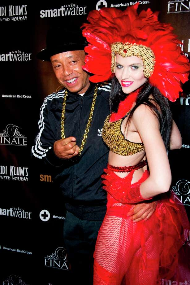Hana Nitsche and Russell Simmons attend Heidi Klum's Haunted Holiday Party benefiting Superstorm Sandy relief efforts, on Saturday, Dec. 1, 2012 in New York. Photo: Charles Sykes/Invision/AP