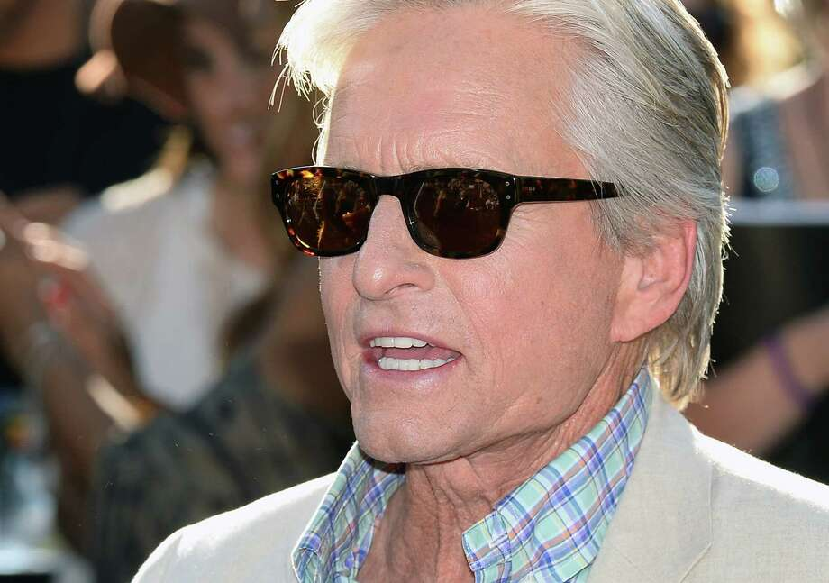 """LAS VEGAS, NV - OCTOBER 18:  Actor Michael Douglas appears in front of the Bellagio as cast members from CBS Films' """"Last Vegas"""" are presented with a ceremonial key to the city of Las Vegas on October 18, 2013 in Las Vegas, Nevada. The movie opens nationwide in the United States on November 1.  (Photo by Ethan Miller/Getty Images) Photo: Ethan Miller, Staff / 2013 Getty Images"""