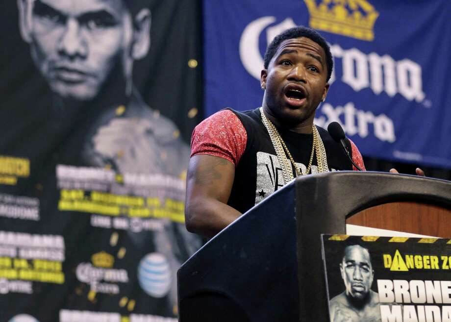 """Adrien """"The Problem"""" Broner, right, trash talks his opponent Marcos """"El Chino"""" Maidana, left, during a press conference for the Dec. 14 fight involving Broner, the WBA Welterweight Champion and Maidana, former WBA Junor Welterweight Champion at the Alamodome. Thursday, Oct. 31, 2013 Photo: BOB OWEN, San Antonio Express-News / © 2012 San Antonio Express-News"""