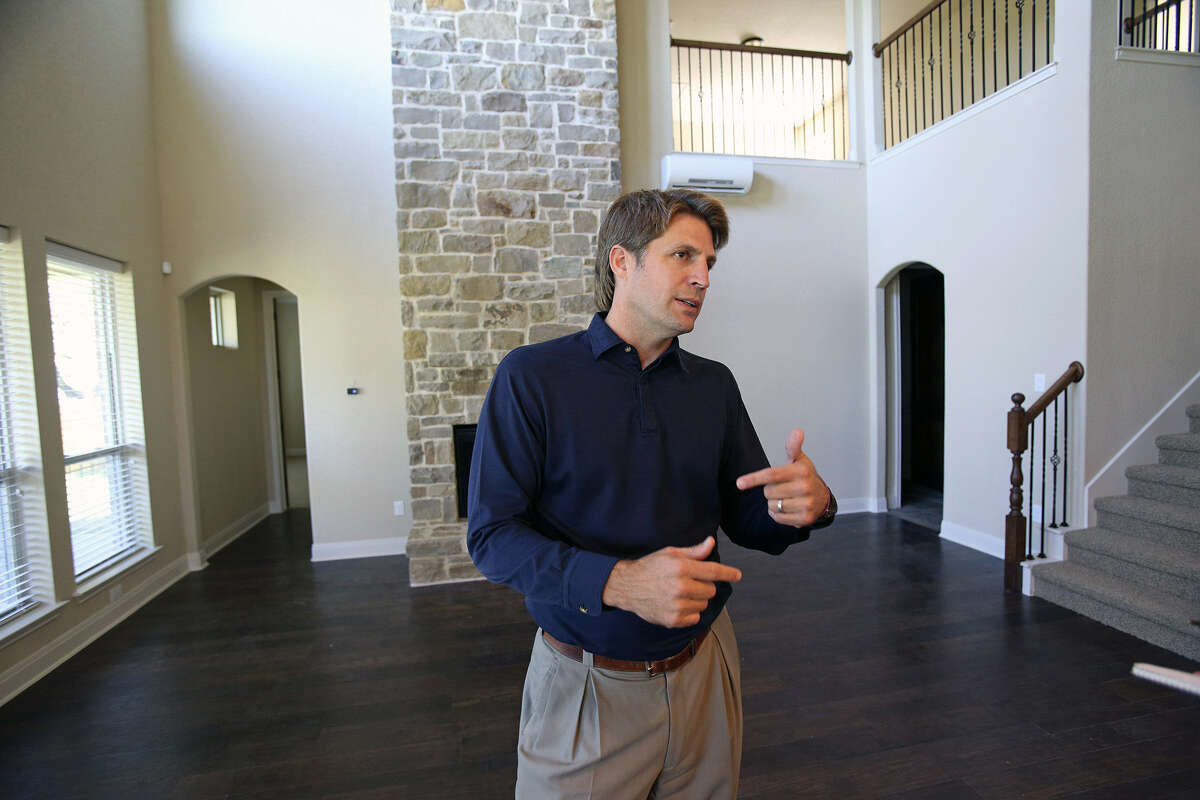 John Friesenhahn of Imagine Homes discusses the energy-saving features of a Building America house in Boerne, which is designed to save as much as 50 percent of energy costs.