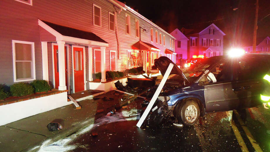 The driver of this van lost control of the vehicle and crashed into a Harbor Avenue apartment early Friday where two women were watching television. Photo: Norwalk Fire Department / Westport News contributed