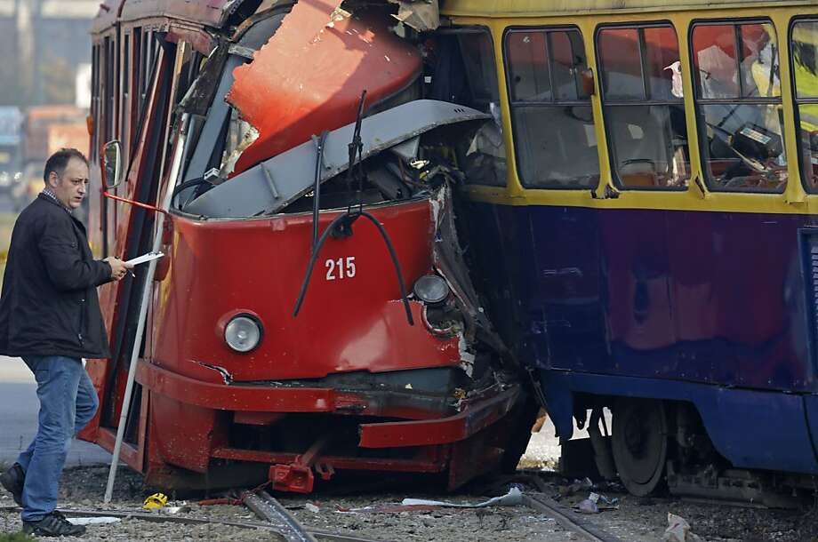 Police investigate the crash site of two streetcars in the Bosnian capital of Sarajevo. About 45 people were injured when one tram slammed into another at a busy downtown intersection. Photo: Amel Emric, Associated Press