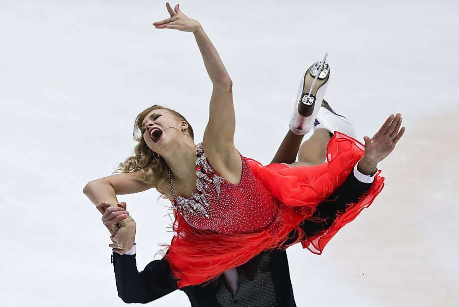If Russia's Ekaterina Bobrova appears a little anguishedduring this stunt in the ice dance short program, maybe it's because her dress has temporarily blinded partner Dmitri Soloviev. (Cup of China Grand Prix of Figure Skating in Beijing.) Photo: Alexander F. Yuan, Associated Press