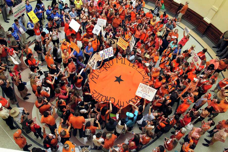 Pro choice supporters gather for a rally in the rotunda as the Senate debates passage of abortion legislation on July 12, 2013. Photo: TOM REEL
