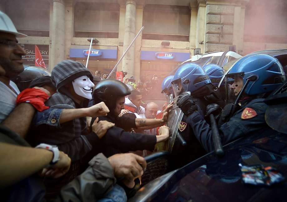 Riot cops clash with Guy Fawkes and other demonstrators during a protest over government austerity measures and the lack of affordable housing in Rome. Photo: Filippo Monteforte, AFP/Getty Images