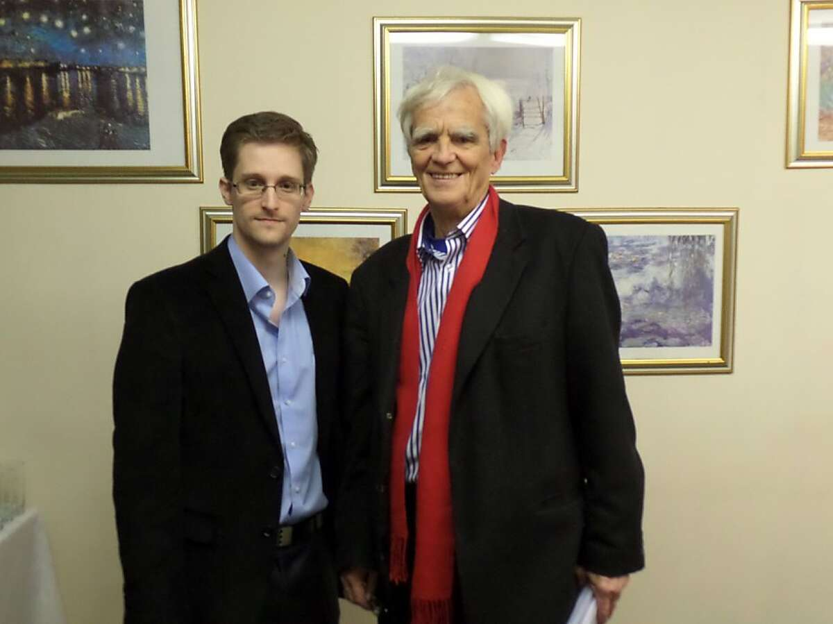 This handout photo made available on the webpage of German Green party parliamentarian Hans-Christian Stroebele shows Hans-Christian Stroebele (R) posing for a photo with former US spy agency contractor Edward Snowden (L) at an undisclosed location in Moscow, on October 31, 2013. Stroebele met Snowden in Moscow Stroebele's office said in a statement, and would give details of the meeting on November 1, 2013 at a press conference in Berlin. Snowden gave Stroebele envelopes with letters addressed to the German government, Germany's Bundestag, the lower house of parliament and to the Federal Public Prosecutor. RESTRICTED TO EDITORIAL USE - MANDATORY CREDIT