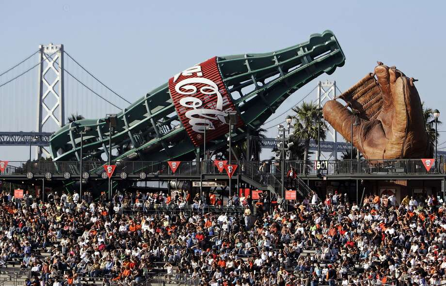 FILE - In an Aug. 5, 2006 file photo, the 60-foot long Coca-Cola bottle stands near left field at AT&T Park in San Francisco. In the background is the San Francisco-Oakland Bay Bridge. San Francisco Supervisor Scott Weiner is set to introduce a ballot measure that would levy a 2-cent-per-ounce tax on all sugar-sweetened beverages sold in the city, the San Francisco Chronicle reported Monday, Oct. 28, 2013. (AP Photo/Eric Risberg, File) Photo: Eric Risberg, Associated Press