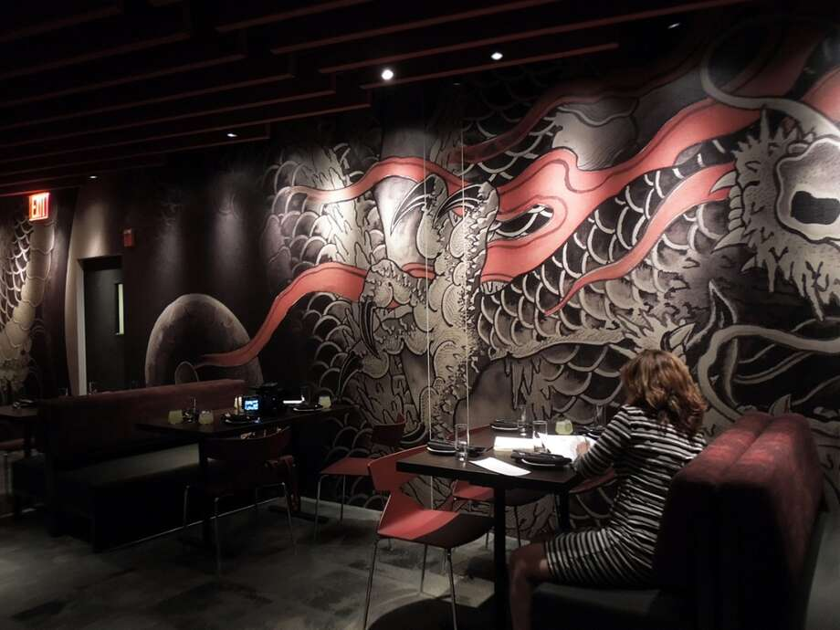 The upstairs features a dragon wall wrapping the entire length of the room
