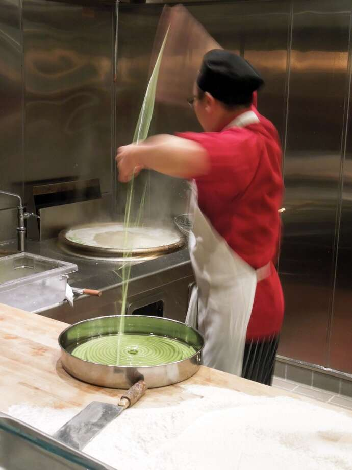 Chef Wu's assistant can spin noodles, too, directly into the boiling water