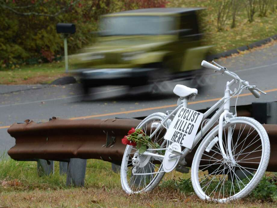 "A white-painted ""ghost bike"" memorial sits at the intersection of Route 302 and Old Hawleyville Road Friday in Bethel, at the scene where 59-year-old Weston resident Thomas Steinert-Threlkeld was killed in a hit-and-run accident Sunday, Oct. 20, 2013. Police have identified the driver but have not released the name. The investigation is continuing. Photo: Tyler Sizemore / The News-Times"