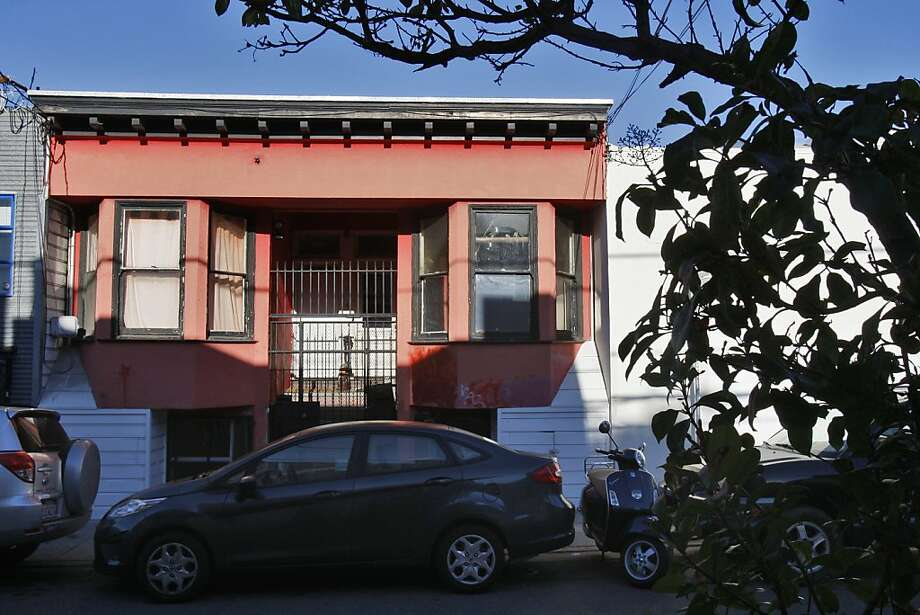 The garages of the old apartment house at 274 Shipley St. in San Francisco's South of Market are well below street level because of the 1906 earthquake. Photo: Raphael Kluzniok, The Chronicle
