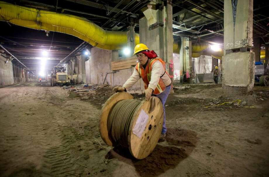 A worker rolls cable through what will become a new LIRR terminal under Grand Central during an MTA tour of the East Side Access Project, which will link the Long Island Rail Road to Grand Central Terminal in New York, on Thursday, Jan. 28, 2010. Photo: Chris Preovolos / Stamford Advocate