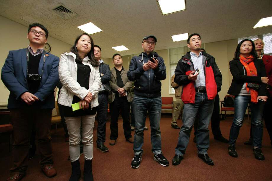 Sixteen journalists from China came to Town Hall to get an understanding of Greenwich as a financial center, commuting base to NYC and a residental center Friday, Nov. 1, 2013. Photo: David Ames / Greenwich Time