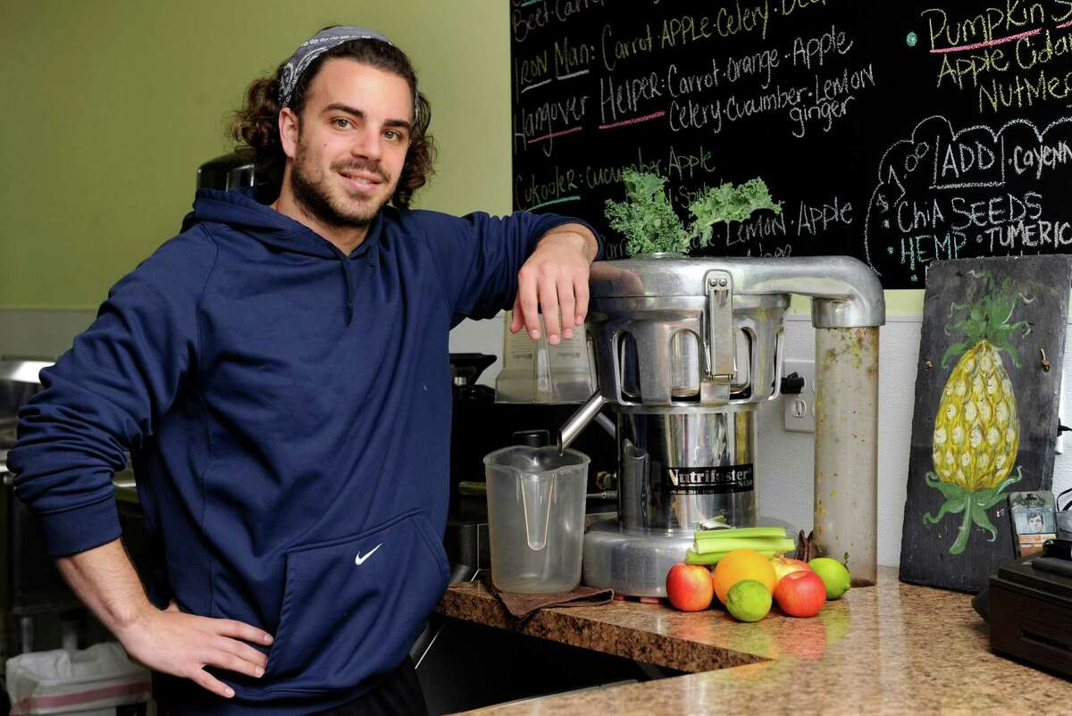 Nick Tiffany, 25, who with his wife Marcelle, 23, owns and runs, the Juice Barre at 16 P.T. Barnum Square in Bethel, Conn., is photographed Friday, Nov. 1, 2013.