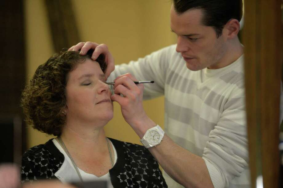 Christopher Byrne applies makeup to Joyce Bassett. Photo by Skip Dickstein.
