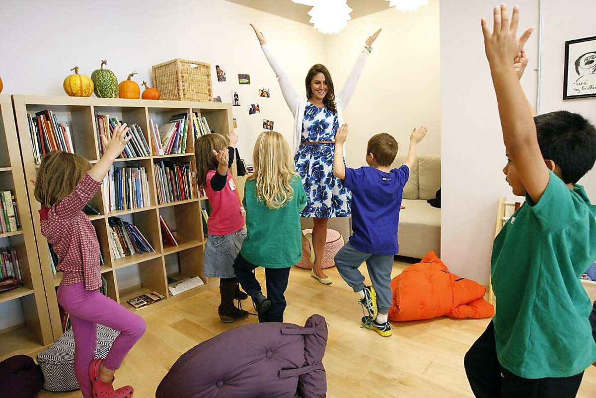 Teacher Sarah Rothenberg leads a group of younger children through a series of yoga inspired stretches at Alt School in San Francisco, CA Friday, October 25, 2013. Alt School was founded by techie Max Ventilla, and uses a start-up mentality towards building a home-schooled environment for children to learn in