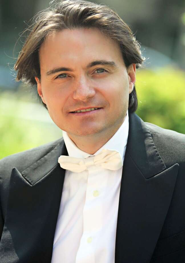 Christian Capocaccia, music director and principal conductor for the Stamford Young Artists Philharmonic, will lead the group in its first concert of the 54th season on Sunday, Nov. 3, 2013, at 4 p.m., at the Palace Theatre, 61 Atlantic St., Stamford. For information on ticket prices, call 203-325-4466 or visit www.scalive.org. Photo: Contributed Photo