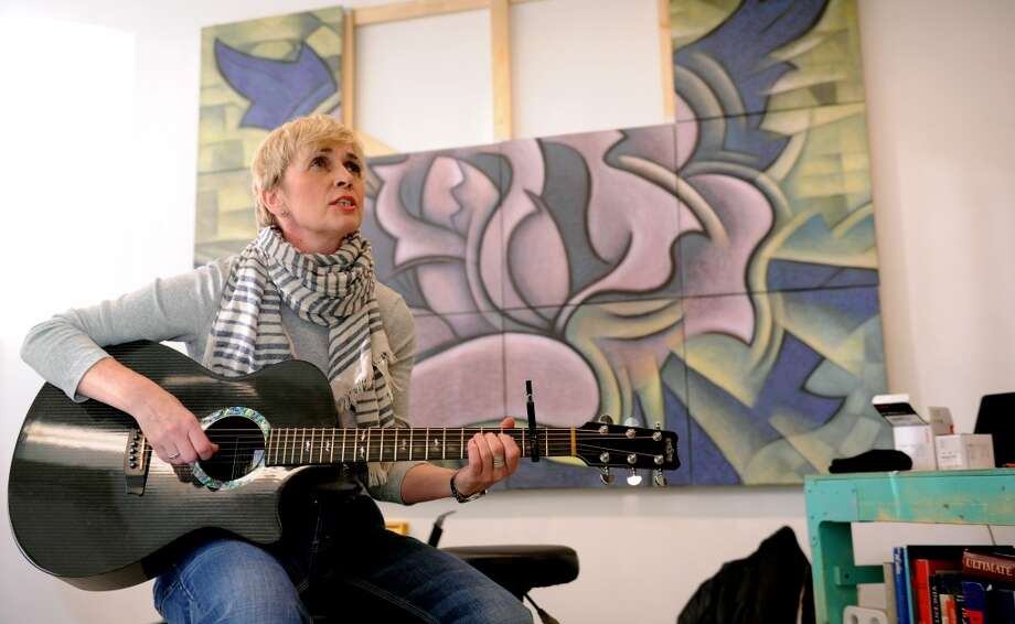 Stamford singer and songwriter Kathy Muir, pictured earlier this year at the former home of the Stamford, Conn.-based Loft Artists Association, is set to perform Friday night when the association welcomes the public to its new studio spaces at 575 Pacific St., Stamford, Conn. Photo: Lindsay Perry