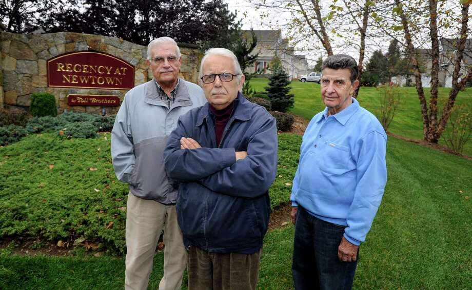 Louis Carbone, 80, left; Rudy Magnan, 72, center; and Rocco Miano, 75, meet at the entrance to Regency at Newtown, where Magnan lives. Carbone and Miano live in a similar community, Liberty at Newtown. The men are part of a group of seniors demanding tax relief. Photo: Carol Kaliff, The News-Times / The News-Times