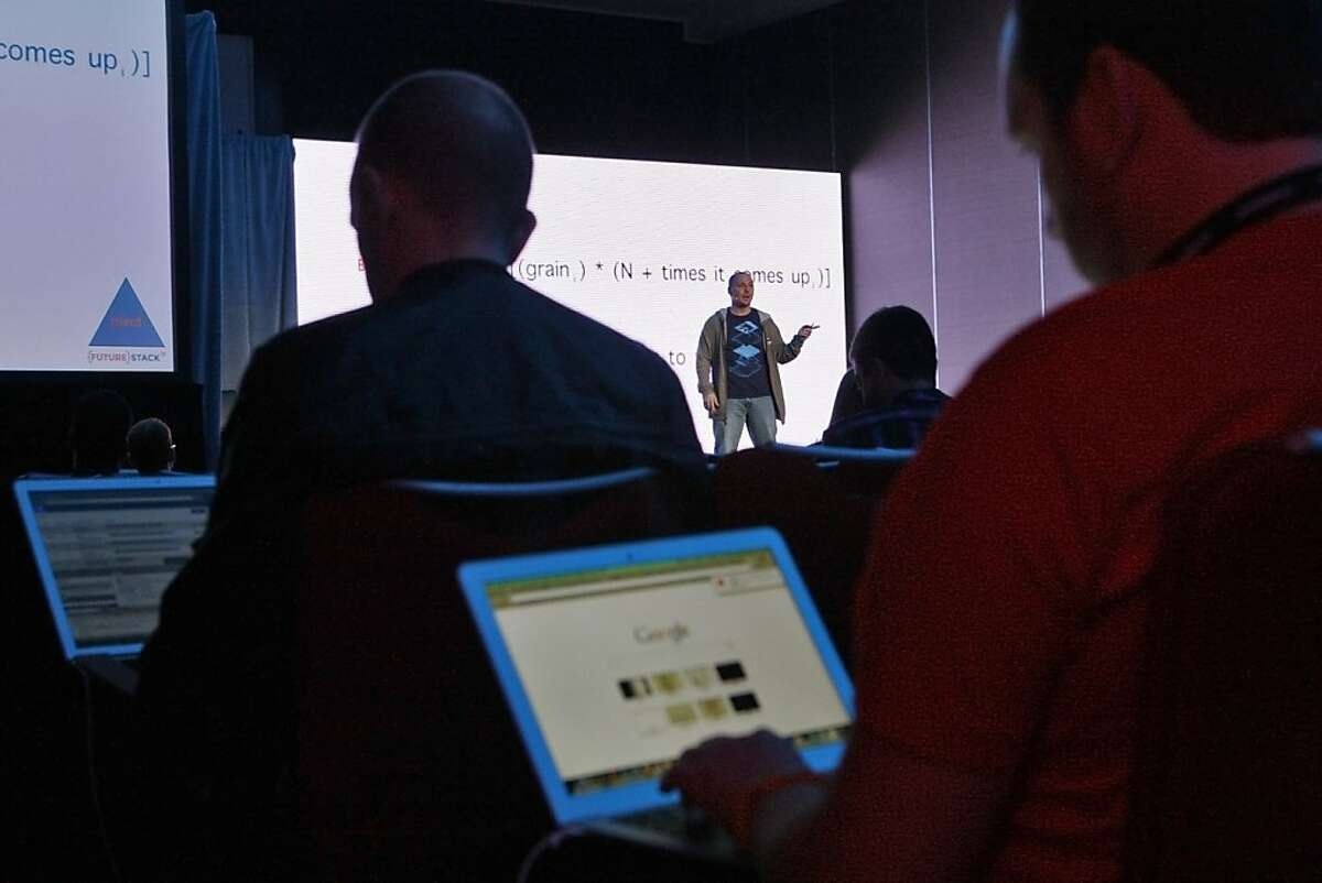 Ren Fournier (left) and Austin Smith work on their laptops during Nick Floyd's Nerd Life Balance presentation during last week's Future Stack conference at the Grand Hyatt in San Francisco.
