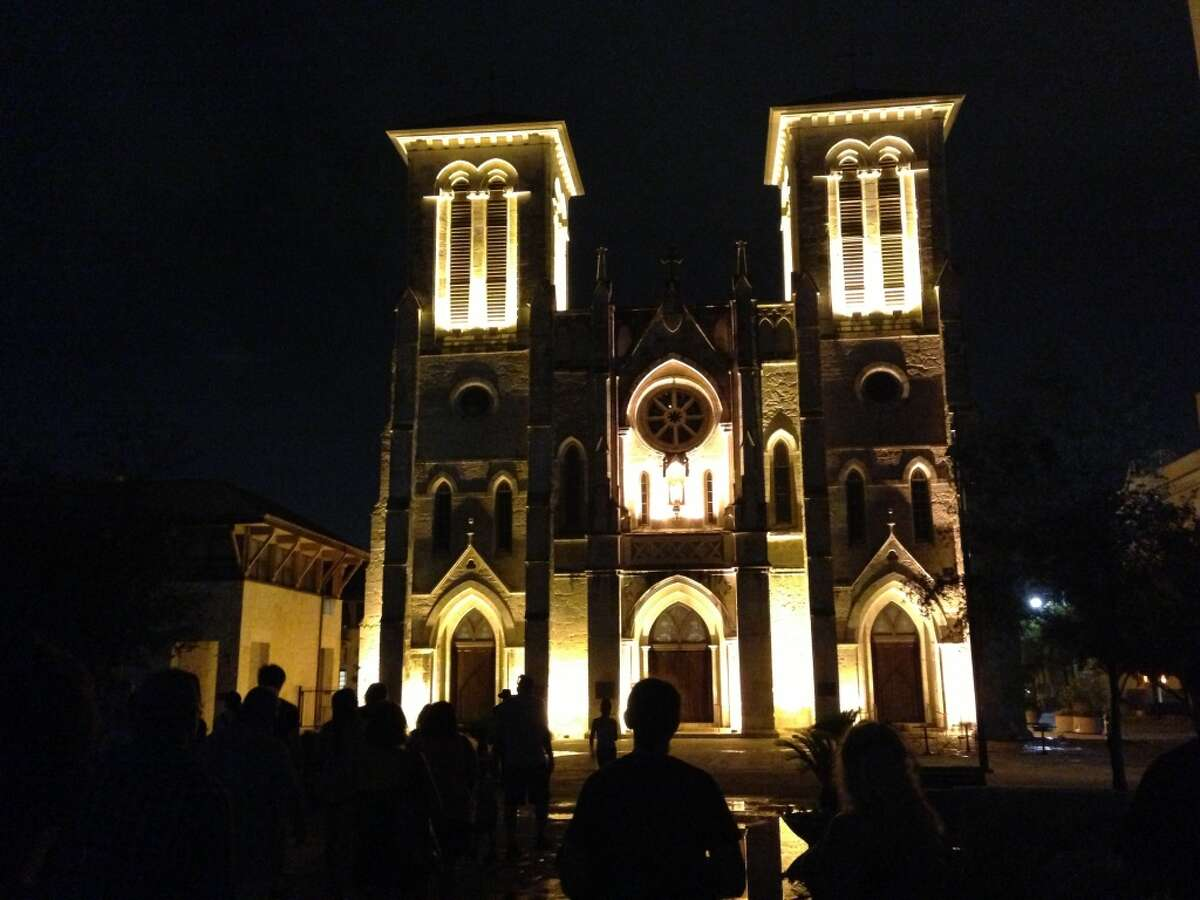 Ghost tour enthusiasts take photos of San Fernando Cathedral.